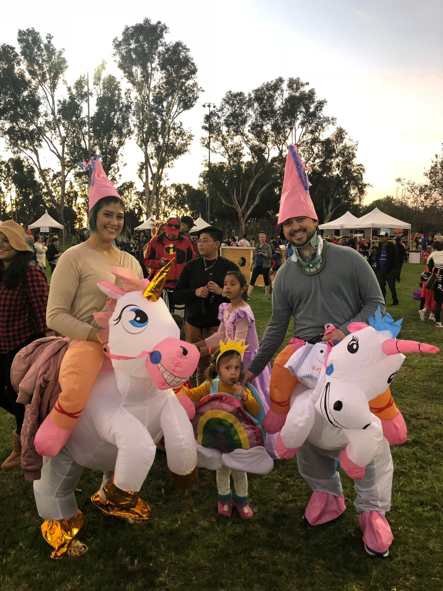 parents and child in halloween costumes
