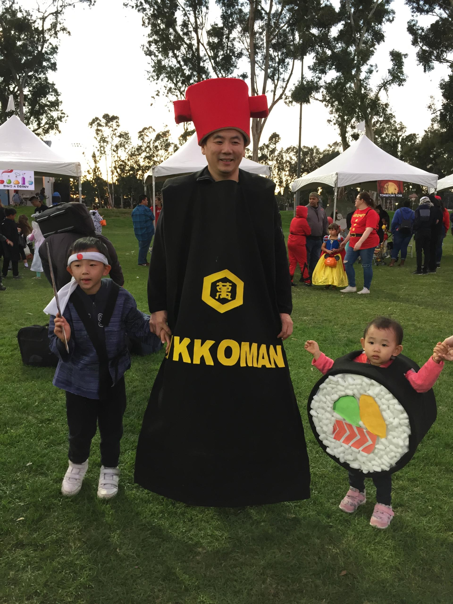 man and children in halloween costumes