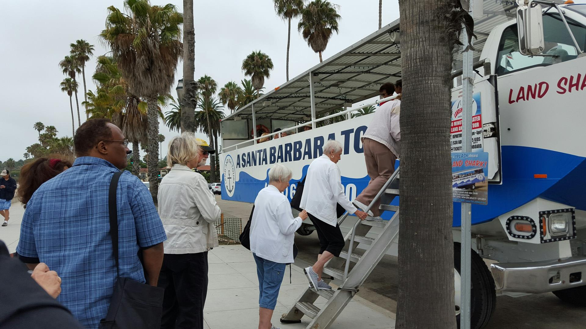 Seniors Boarding a Tour Bus in Santa Barbara